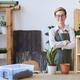 Smiling Woman Potting Plants - PhotoDune Item for Sale