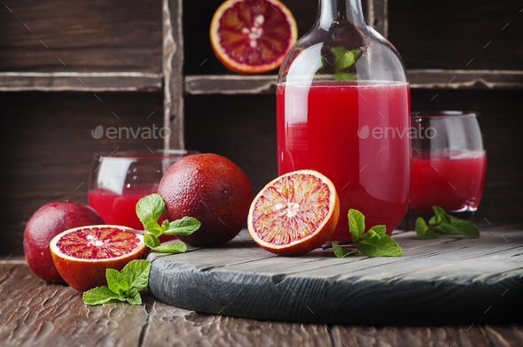 Sweet juice with red oranges and mint - Stock Photo - Images