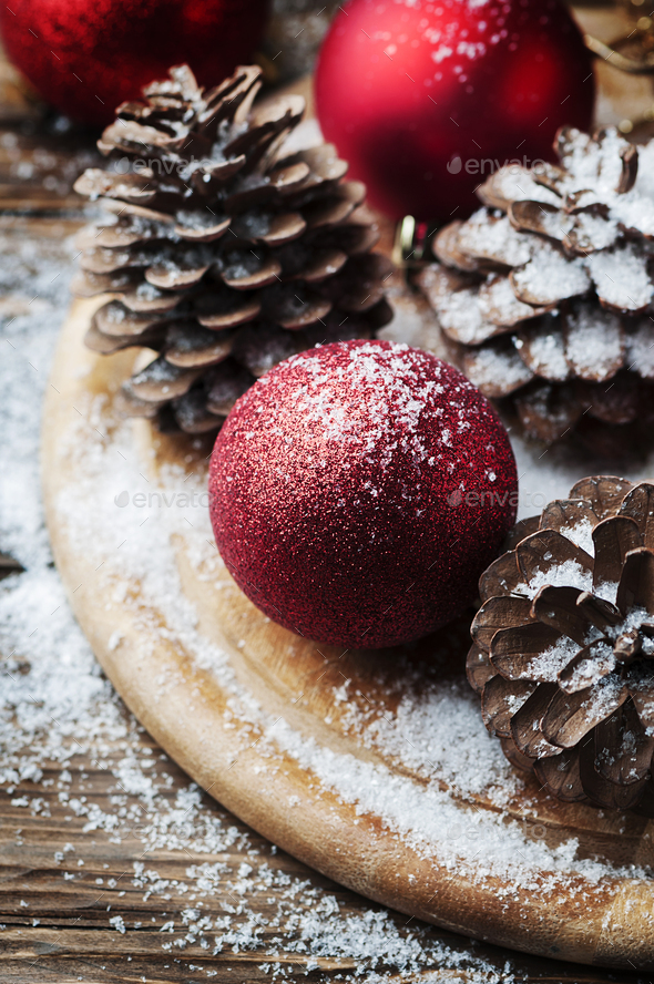Christmas card with cones and red balls on the wooden table - Stock Photo - Images