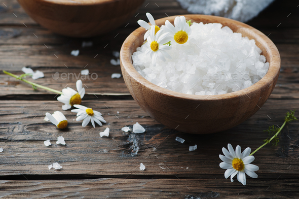 Concept of spa treatment with salt and daisy - Stock Photo - Images