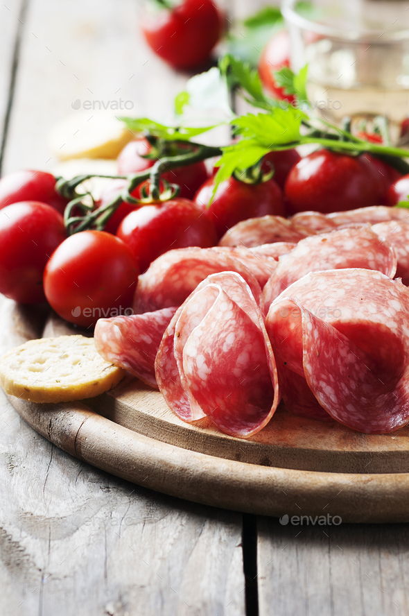 Fresh salami with tomato and bread - Stock Photo - Images