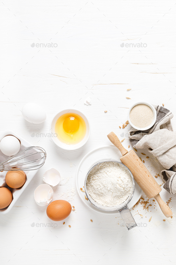 Baking homemade bread on white kitchen worktop with ingredients for cooking, culinary background - Stock Photo - Images