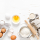 Baking homemade bread on white kitchen worktop with ingredients for cooking, culinary background - PhotoDune Item for Sale