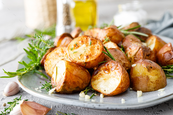 Baked potatoes with rosemary, thyme and garlic - Stock Photo - Images