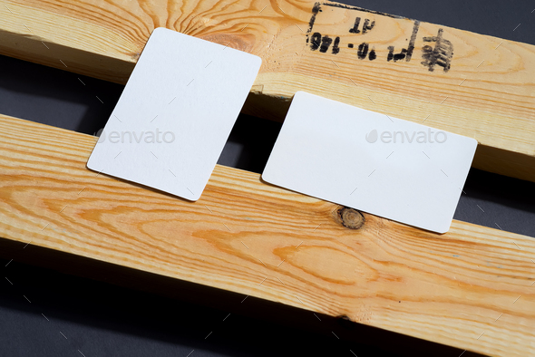 blank business cards on black and wooden background, good for texte and logo - Stock Photo - Images