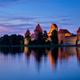 Trakai Island Castle in lake Galve, Lithuania - PhotoDune Item for Sale