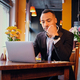 Thoughtful male in a cafe using laptop. - PhotoDune Item for Sale