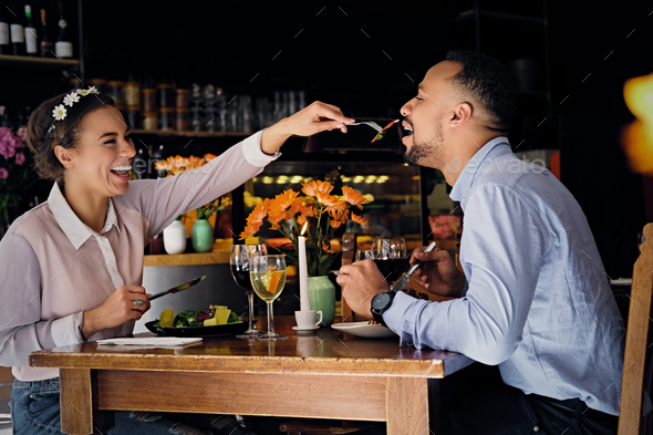 Black American male and female eating vegan food. - Stock Photo - Images