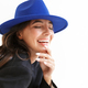 Optimistic happy woman in blue hat posing isolated - PhotoDune Item for Sale