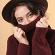 Brunette woman covering face with sweater. - PhotoDune Item for Sale