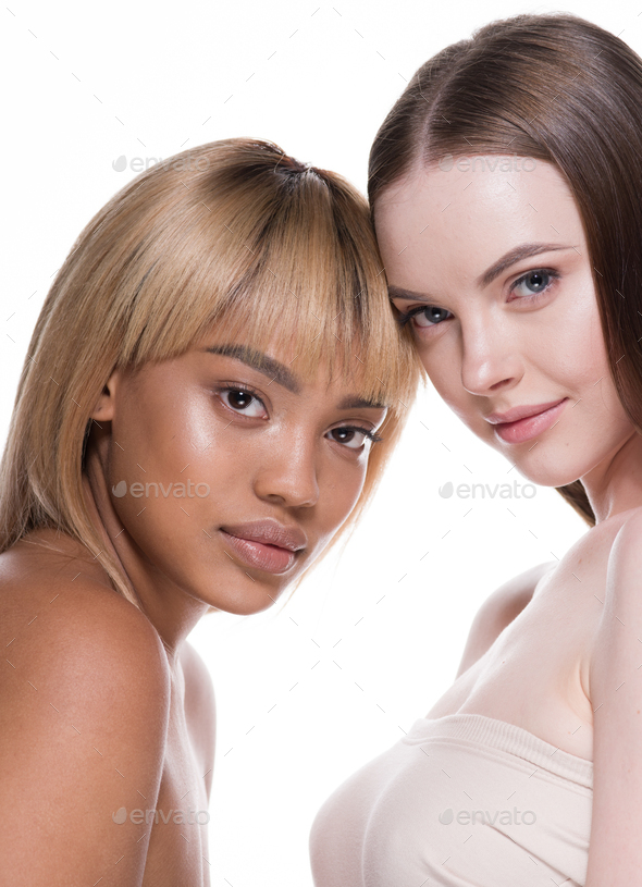 Women black and white skin ethnic beauty cosmetic skin care - Stock Photo - Images
