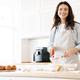 Image of caucasian smiling woman preparing dough for sweet pie - PhotoDune Item for Sale