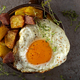 Egg with fries and fried salami in a rustic pan - PhotoDune Item for Sale