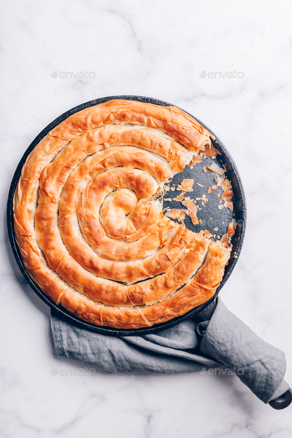 Filo Spinach and Feta Twist Pie - Stock Photo - Images