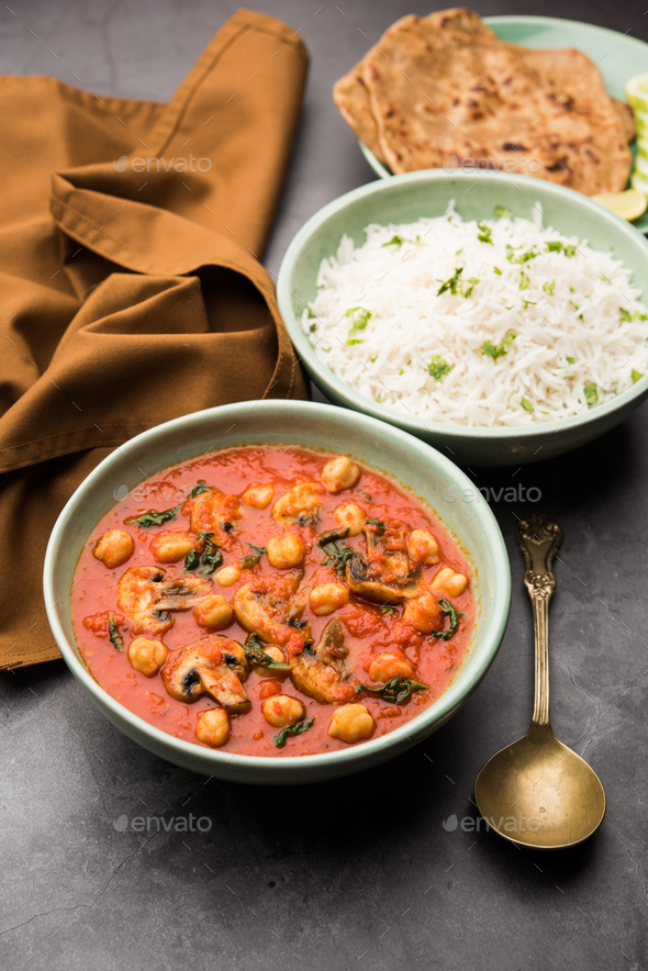 Indian Style Mushroom Chickpea curry in red sauce - Stock Photo - Images