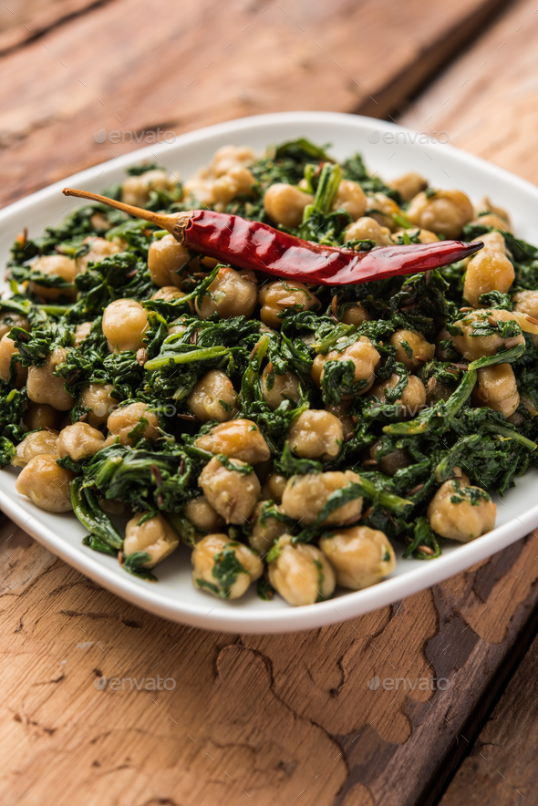 Spinach chickpea Dry Curry / Palak chana Sukhi masala sabzi - Stock Photo - Images