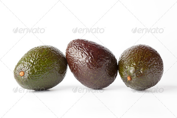 Three avocado's in a row - Stock Photo - Images