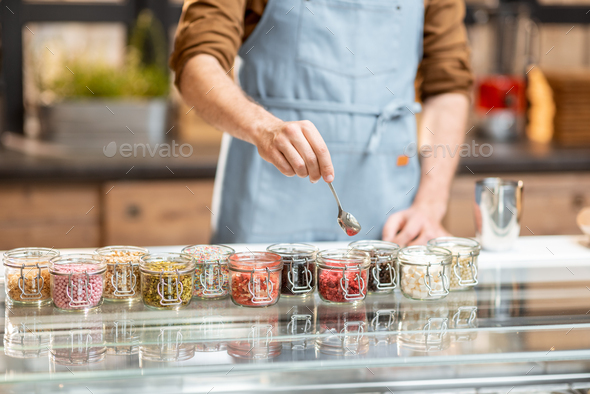Chef making ice cream with toppings - Stock Photo - Images