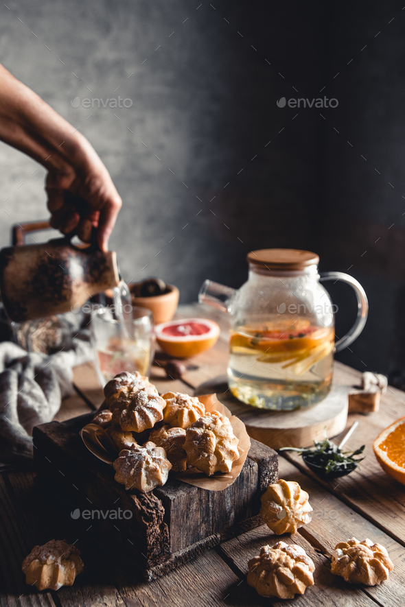 Tasty cakes with Hot tea with slices of fresh grapefruit on wooden tablet. Healthy drink, Eco, vegan - Stock Photo - Images