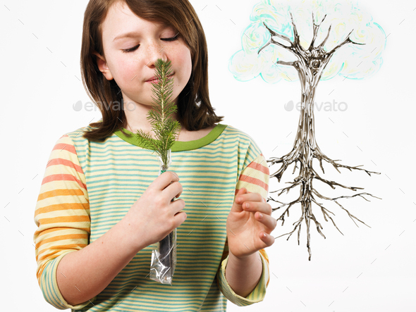 A young girl smelling a plant. An illustration of the plant with roots. - Stock Photo - Images
