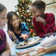 A group of children around a table, decorating organic Christmas cookies. - PhotoDune Item for Sale