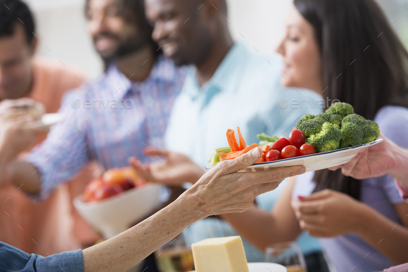 Working lunch, a salad buffet in an office,colleagues of mixed ages and ethnicities - Stock Photo - Images