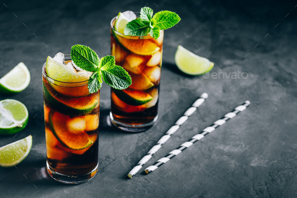 Rum and Cola Cuba Libre ice cold drink cocktail with lime and mint - Stock Photo - Images