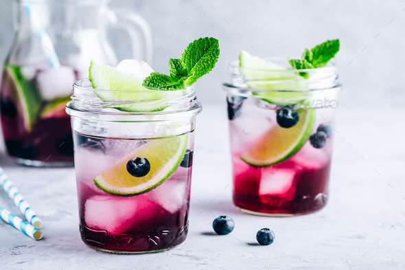 Blueberry and lime mojito or lemonade. Refreshing summer drink - Stock Photo - Images