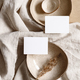 Blank paper sheet cards on bowls. Minimalist ceramics set over a linen cloth. - PhotoDune Item for Sale