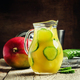 Vitamin lemonade in a jug, with syrup, juice, mango, cucumber and ice - PhotoDune Item for Sale