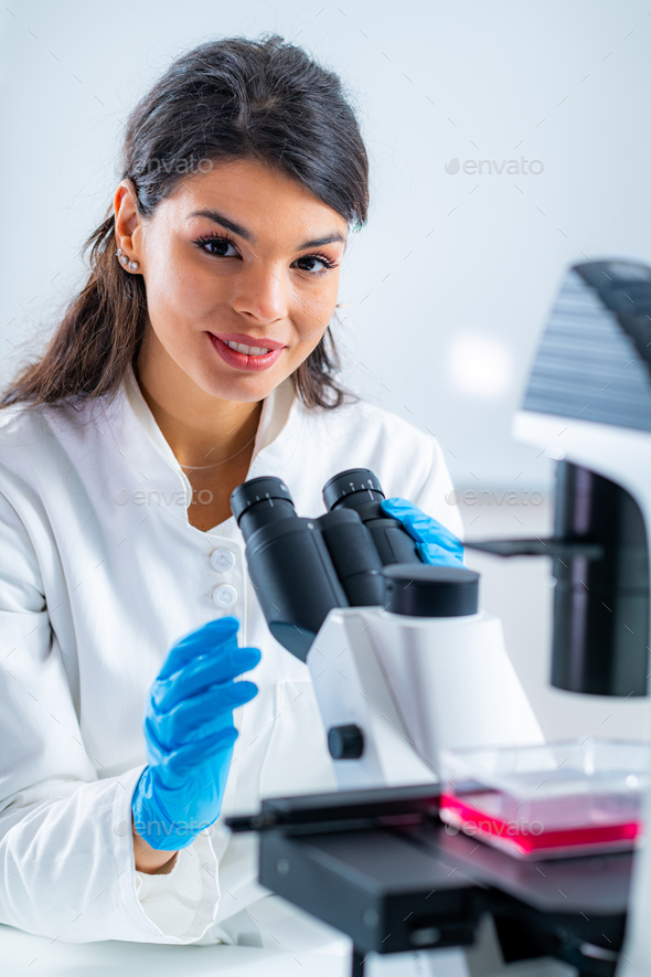 Female Junior Researcher in the Lab - Stock Photo - Images