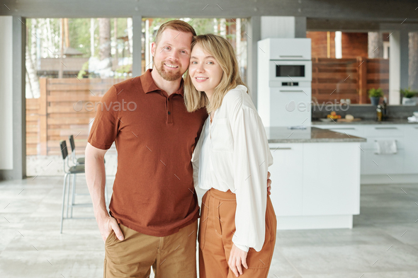 Happy beautiful couple in cottage house - Stock Photo - Images