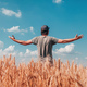 Successful wheat farmer standing in ripe cereal crop field - PhotoDune Item for Sale