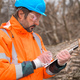 Forestry technician collecting data notes in forest - PhotoDune Item for Sale