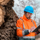 Forestry technician writing notes on clipboard notepad paper in forest - PhotoDune Item for Sale