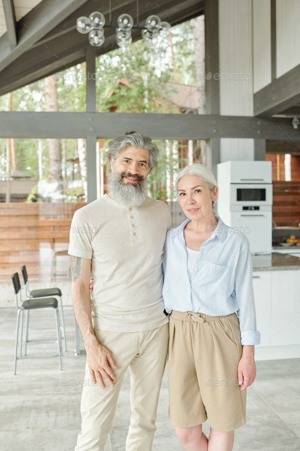 Modern senior couple living in big house - Stock Photo - Images
