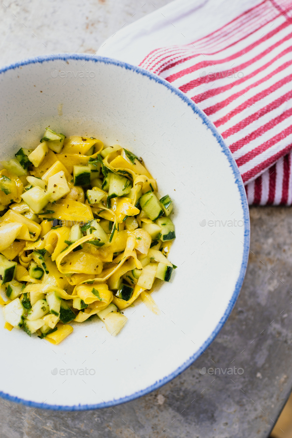 Raw zucchini and cucumber salad - Stock Photo - Images