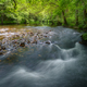 River in summer with low flow that shows the boulders of the bed - PhotoDune Item for Sale