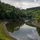 Removes water from a river reflecting the environment of mixed forests and cloudy sky - PhotoDune Item for Sale