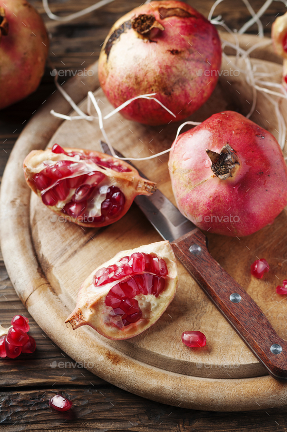 Italian red pomegranate on the wooden table - Stock Photo - Images