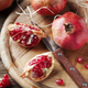 Italian red pomegranate on the wooden table - PhotoDune Item for Sale