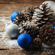 Blue balls and christmas cones on the wooden table - PhotoDune Item for Sale