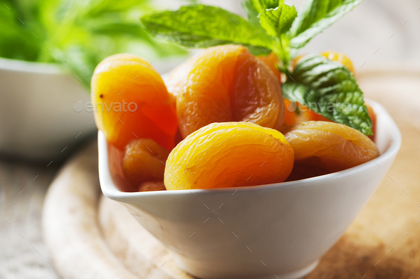 Sweet dried apricots and mint on the wooden table - Stock Photo - Images