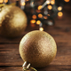 Christmas garland and gold balls on the wooden table - PhotoDune Item for Sale