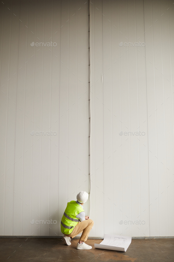 Worker working with wiring - Stock Photo - Images