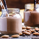 Banana chocolate smoothie with almonds in glass jars - PhotoDune Item for Sale