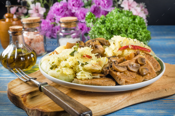 Braised pork loin with mushrooms. - Stock Photo - Images