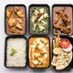 Online food delivery concept for Indian Restaurant showing plastic containers with food - PhotoDune Item for Sale