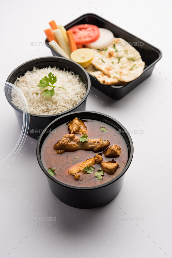 Chicken Curry Masala packed in plastic container for home delivery - Stock Photo - Images