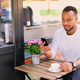 Black male drinks coffee and using smartphone. - PhotoDune Item for Sale
